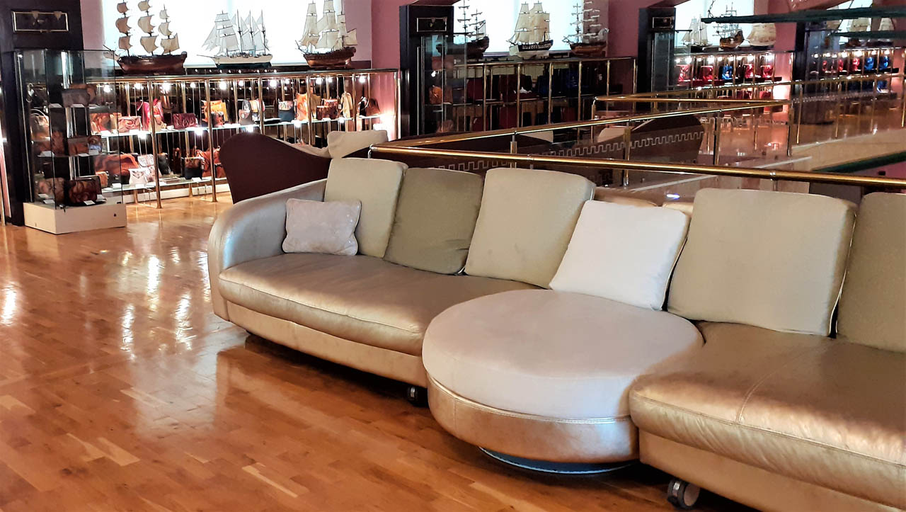 Gold sofa at gallery mezzanine floor welcome drink wedding reception athens glyfada barin events
